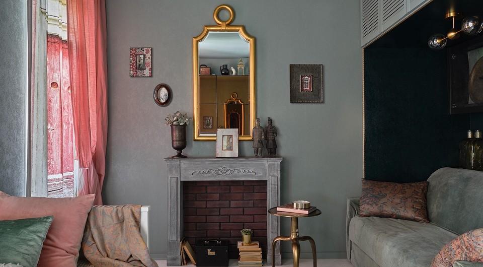 Темные цвета и много декора: интерьер маленькой студии, который рушит стереотипы
