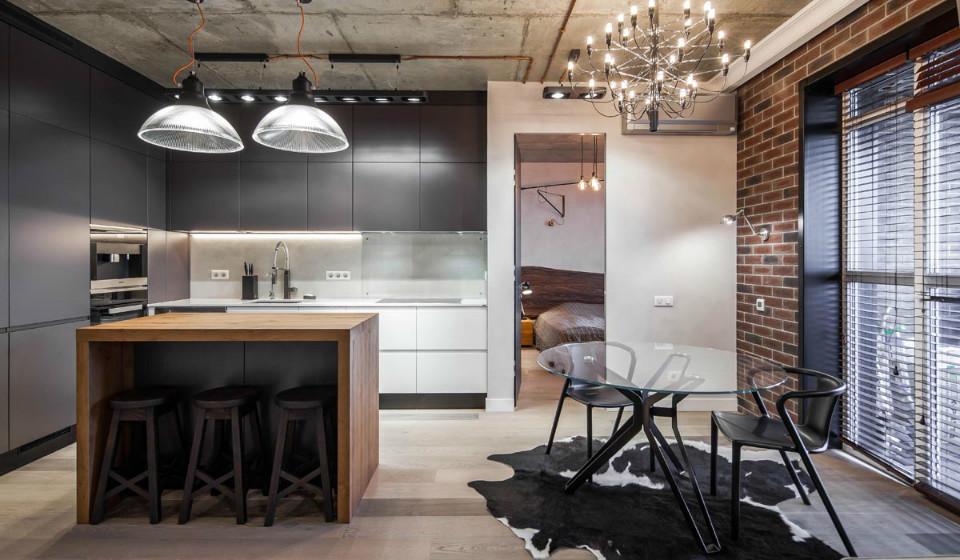 Интерьер в стиле лофт: кирпичные стены и деревянная мебель