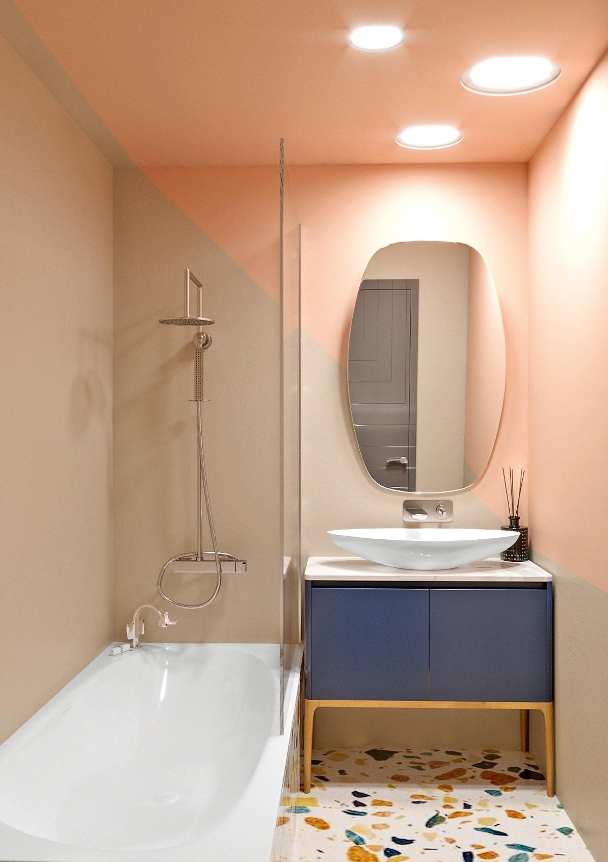 Стены помещения выкрасят влагостойким составом в три тона — светло-серый, пудровый и белый, пол сделают бесшовным, для чего используют инженерный мрамор Marmoreal. Объём ванной очень небо...