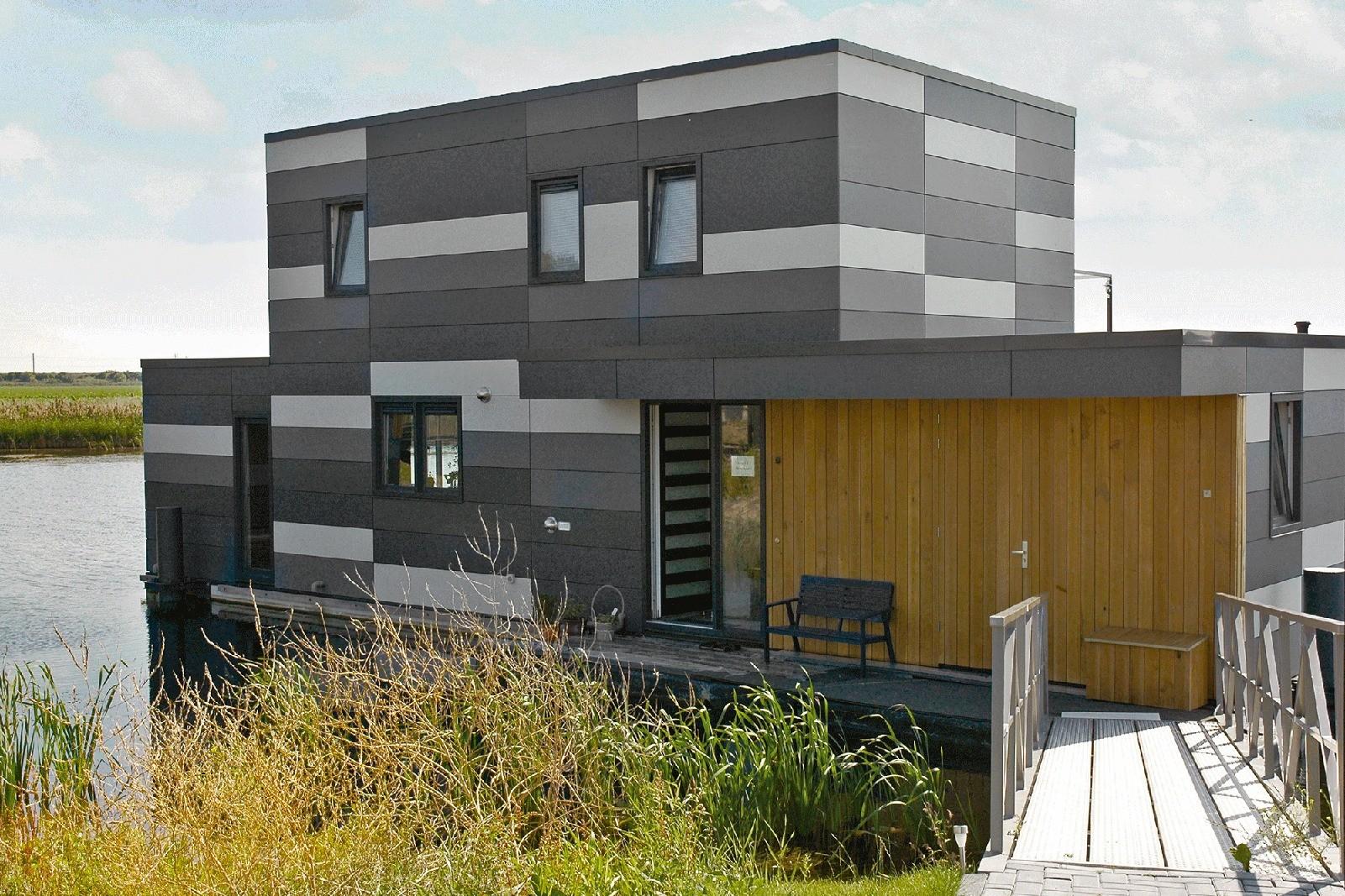Фиброцементные панели Equitone — это окрашенный в массе фасадный материал