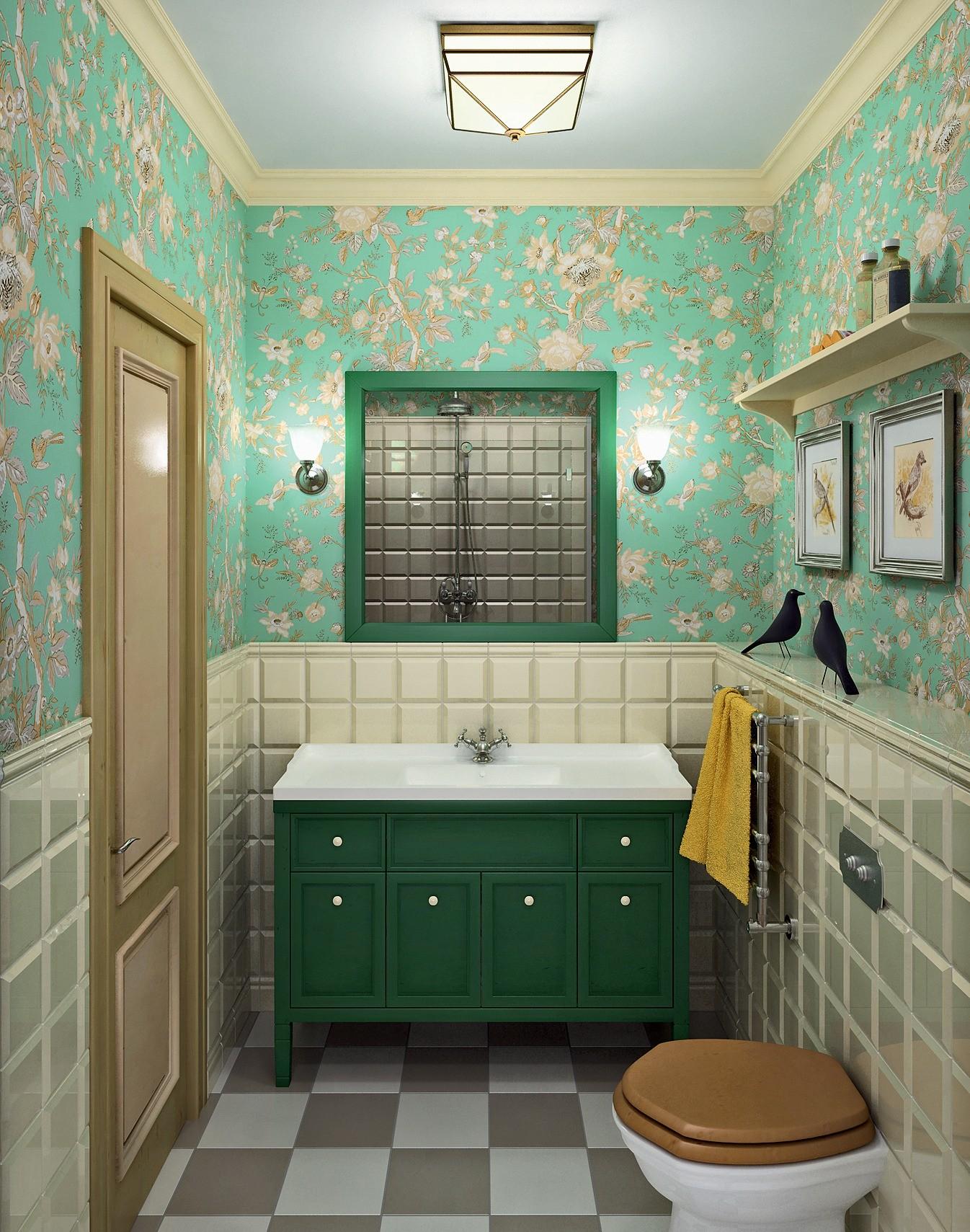 Большая часть стен на высоту 1,2 м облицована небольшой плиткой с крупной фаской, а выше оклеена обоями с цветочным принтом. Тёмно-зелёная крашеная тумба под раковину и гравюры Томаса Бью...