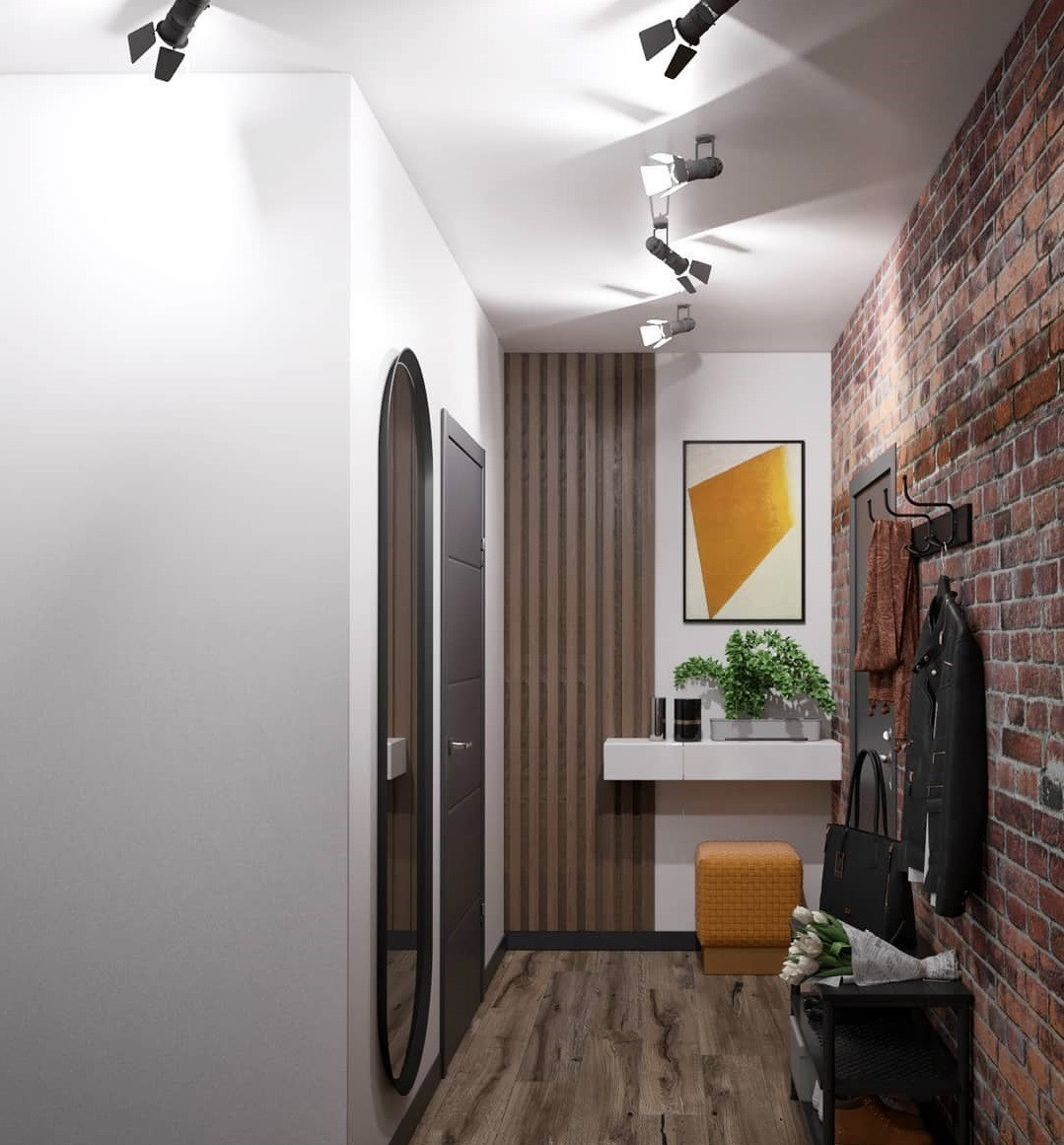 Дополнить кирпичную стену можно брутальным декором, хотя она и сама по себе выглядит эффектно