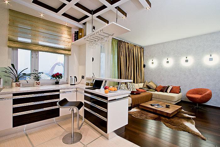 Украшением гостиной стали настенные светильники Osram. Декоративным элементом в них является лампа  в форме обруча, обрамляющая центральную вставку